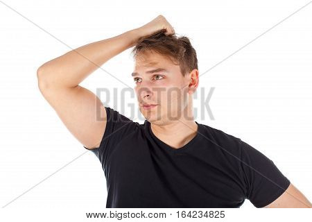 Picture of a stressed young man standing on an isolated background