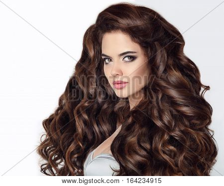 Long Hair. Beautiful Brunette Woman Portrait With Curly Shiny Hair Isloated On Studio White Backgrou