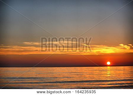 Beautiful sunset over a quiet calm ocean