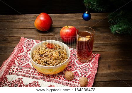 Dish is a traditional Slavic treat on Christmas Eve on a towel. Fruit drink apples