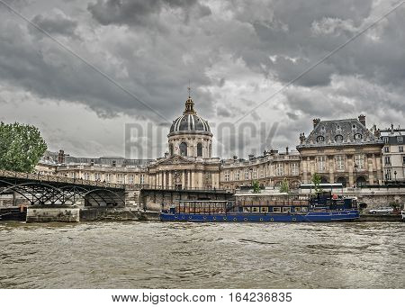 Paris France. View from the Seine River on the Arts Bridge and French Institute.