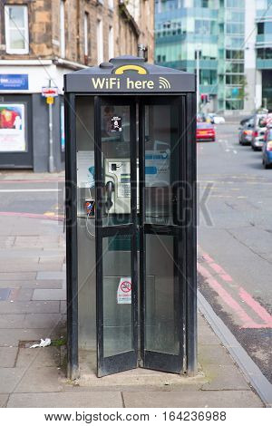 Edinburgh Scotland - September 10 2016: callbox with wifi hotspot. Edinburgh is the capital of Scotland its old and new town are UNESCO listed
