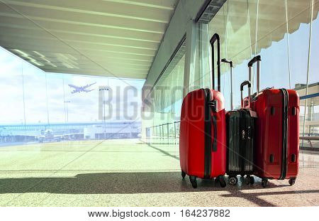 stack of traveling luggage in airport terminal and passenger plane flying for air transport and treveling theme poster