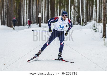 Kyshtym Russia - March 26 2016: male skier athlete men in winter woods free style during Championship on cross country skiing