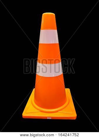 Orange traffic road cone pylon isolated on black background
