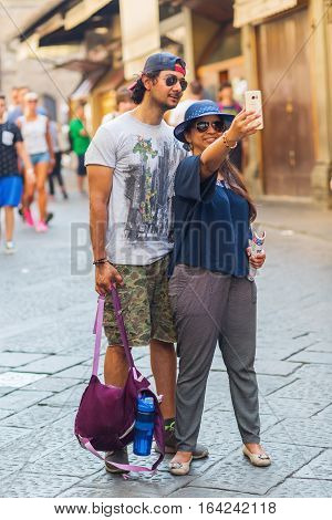 People Making Selfies On Ponte Vecchio, Florence