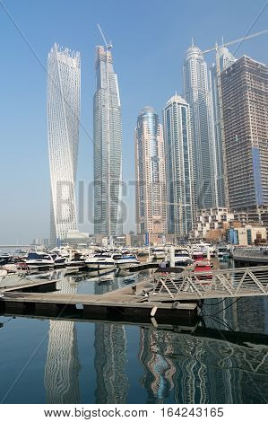 DUBAI, UNITED ARAB EMIRATES - DECEMBER 7, 2016: Modern buildings in Dubai Marina, Dubai, UAE. Dubai Marina is an artificial canal city, built along a two-mile (3 km) stretch of Persian Gulf shoreline.