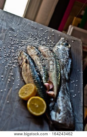 blue fish freshly caught great for a healthy diet ready to be cooked with lemon and oil