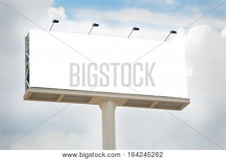 Outdoors billboard in blank with a cloudy sky behind.