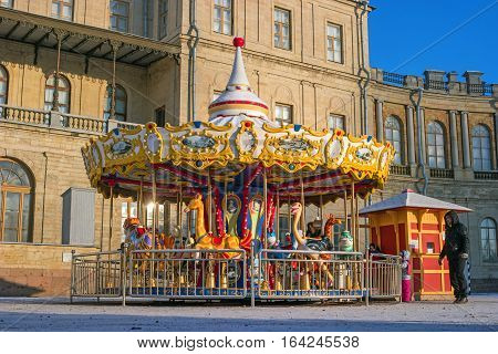Gatchina, Russia - January 6, 2017: Gatchina Palace, New Year's Fair on the parade ground. Children's carousel at the fair.