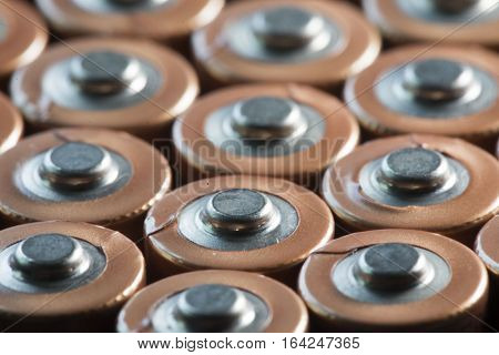 contacts at the positive pole of used batteries and rechargeable cells of the size AA
