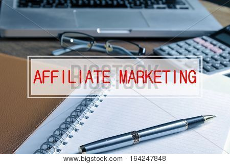 Notebook With Calculator, Keyboard And Pen On Table With Text Affiliate Marketing