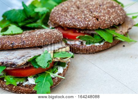 Healthy sandwich with rye bun beef and vegetables. Healthy homemade food