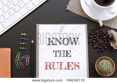 Text Know the rules on white paper background / business concept