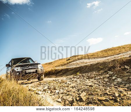KRASNODAR RUSSIA - SEPTEMBER 25 2016: legendary japanese Mitsubishi Pajero-4 walks on the russian scorched hills