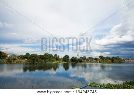 Panorama shot of peaceful riverside city landscape in country side.
