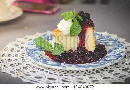 Blueberry cake with blueberry sauce. homemade blueberry cake with whipped cream and fresh blueberry sweet sauce.(selective focus)