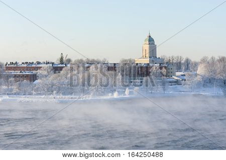 Suomenlinna isle and its buildings in Helsinki Finland in a steaming sea at winter
