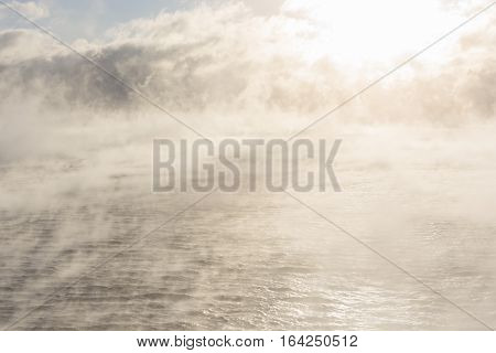 Extremely misty and steamy sea at cold winter morning