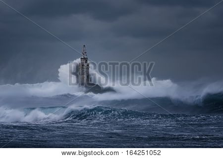 Stormy cloudy day. Dramatic sky and huge waves at the Lighthouse, Ahtopol, Bulgaria