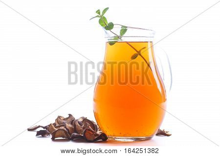 compote of dried fruits in a carafe on a white background