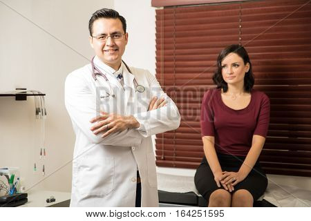 Handsome Doctor Examining A Patient