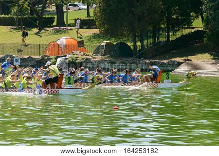 Rome Italy - July 30 2016: Dragon boat crews compete at the european championships held in Italy in 2016 summer in the photo the Italian crew against the Ukraine crew during the race