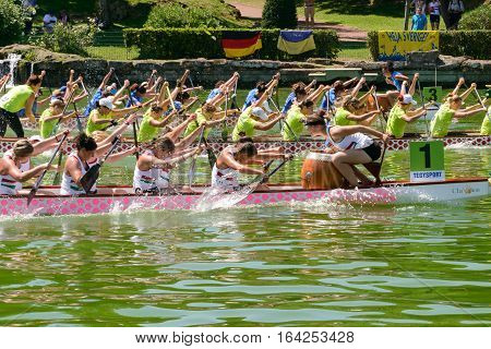 Rome Italy - July 30 2016: Dragon boat crews compete at the european championships held in Italy in 2016 summer in the photo the Italian crew against the Ukraine and Hungary crew during the race