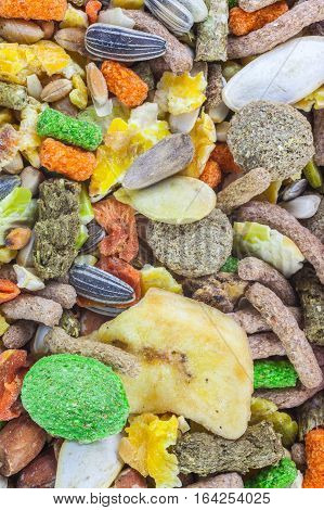 Rodent food mix of grains and seeds as background