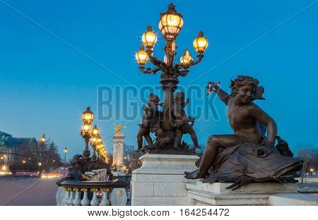 The bridge Alexandre III is a deck arch bridge that spans the Seine in Paris. It is widely regarded as the most ornate extravagant bridge in the city. It is classified as French historic monument