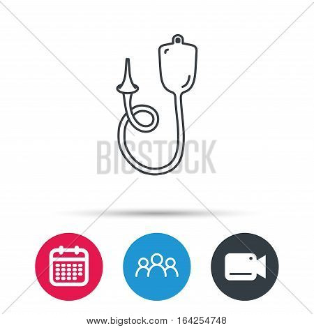 Enema icon. Medical clyster sign. Group of people, video cam and calendar icons. Vector