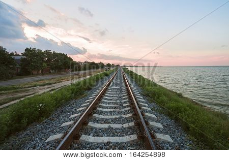 The railway line along the coast of the estuary of the Yeisk, Krasnodar region, Russian Federation