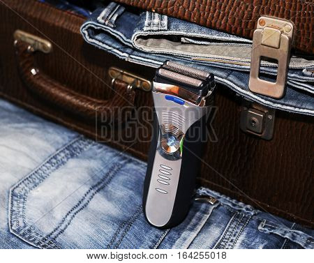 Razor and a suitcase with jeans, style