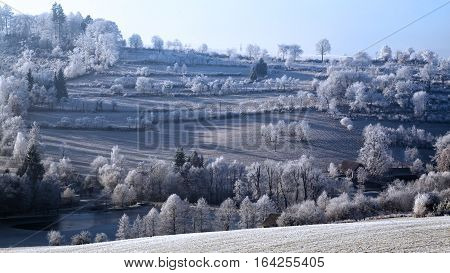 Frozen landscape with rime winter snow valley