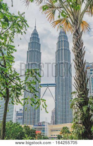 Kuala Lumpur, Malaysia - February 10, 2016: Majestic view of Petronas Twin Towers at sunset in Kulala Lumpur Malaysia.