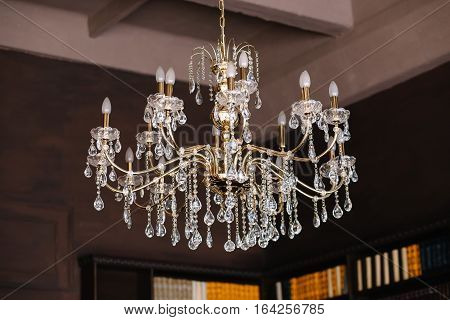 classic vintage golden chandelier adorned with beads and crystals