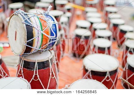 Tablas membranophones pair of small drums. Handicrafts on display during the Handicraft Fair in Kolkata earlier Calcutta West Bengal India. It is the biggest handicrafts fair in Asia. poster