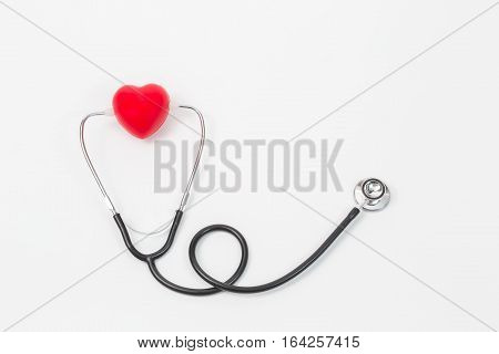 Healthy concept;Red heart and a stethoscope on white background