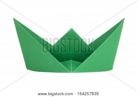 Green paper boat on a white background