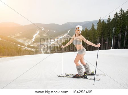 Happy Beautiful Naked Girl Skier Posing On The Snowy Slope With Ski Equipment