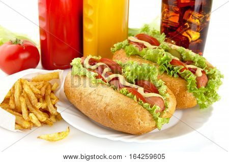 Hotdogs On Plate With Cola And French Fries On White