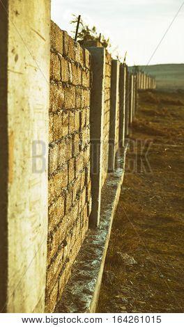 Old stone wall of limestone. Toned photo