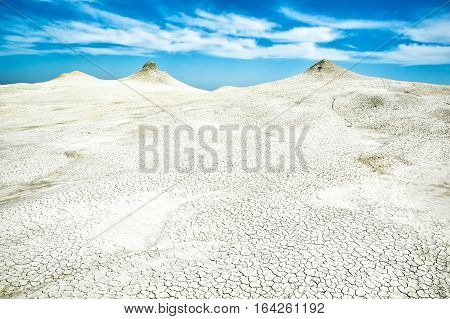 Mud volcano landscape photo with dramatic cloudy sky