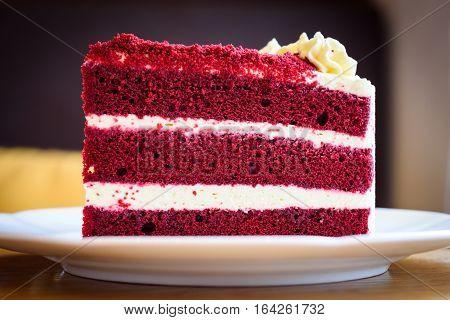 Closeup Velvet red cake on white plate