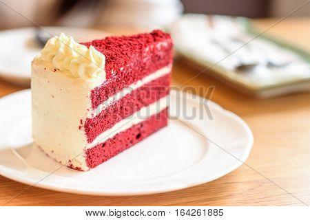 Velvet red cake on white plate wood table