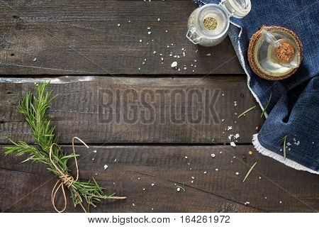 Sprigs Of Rosemary Tied With String, Oil And Spices On A Wooden Table. Copy Space.