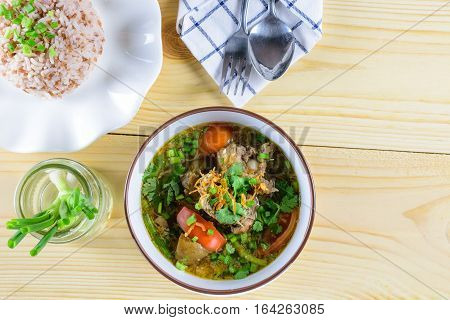 Soup with beef vegetables bone broth as base and boiled rice