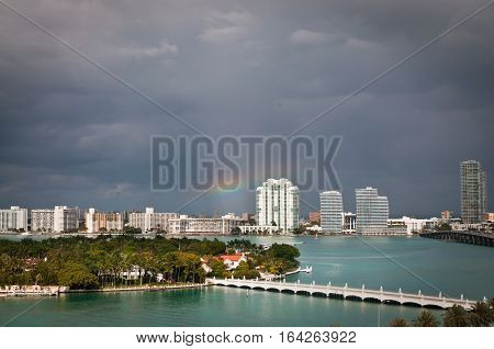 Stormy clouds and rainbow over Star Island and South Miami Beach