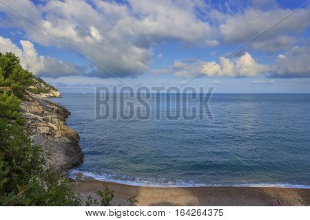Apula coast,Gargano National Park: Pungnochiuso beach. Vieste,Italy.The bay is bounded by marvellous hills covered with age-old pine trees.