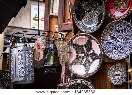 Moroccan metal lamps and ceramic in the shop in medina of Marrakesh